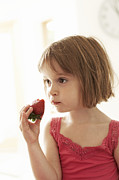 Kid Eating Snack Prints - Girl Eating A Strawberry Print by Ian Boddy