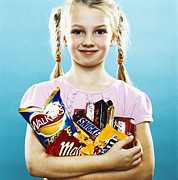 Snacking Prints - Girl Holding Crisps And Chocolate Print by Kevin Curtis