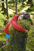 Embracing Prints - Girl Hugging A Tree Stump Print by David Nunuk