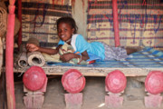 Burkina Faso Prints - Girl on a Straw Mat Bed Print by Irene Abdou