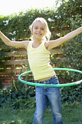 Hula Posters - Girl Playing With A Hula Hoop Poster by Ian Boddy