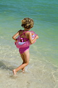 Swimsuit Photography Prints - Girl running into water on beach Print by Sami Sarkis