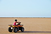 10:11 Prints - Girl speeding on ATV in desert Print by Sami Sarkis