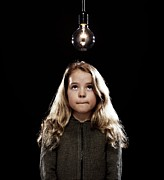 Gifted Posters - Girl Standing Beneath A Lightbulb Poster by Kevin Curtis
