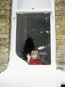 Ledge Framed Prints - Girl Staring Out Of Snowy Window Framed Print by Ian Boddy
