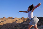 Enjoyment Photos - Girl throwing stone in sky by Sami Sarkis