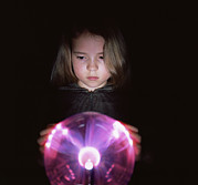 Plasma Framed Prints - Girl Touching A Plasma Globe Framed Print by Kevin Curtis