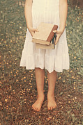 Standing Posters - Girl With Old Books Poster by Joana Kruse