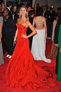 Red Dress Framed Prints - Gisele Bundchen Wearing An Alexander Framed Print by Everett