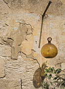 Decorative Glass Art - Glass Ball Hanging from Plaster Wall by Noam Armonn