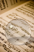 Magnification Prints - Glass Ball on Sheet Music Print by Utah Images