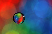 Intensity Photo Posters - Glass bubble in red green blue Poster by Al Hurley