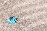 Glass Pebble Posters - Glass pebbles on the sand Poster by Vaidas Bucys