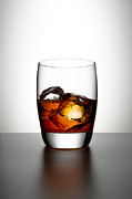 Half Full Framed Prints - Glass With Brown Liquor And Ice Cubes Framed Print by Chris Stein