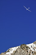 Sami Sarkis Posters - Glider flying over snowy mountain Poster by Sami Sarkis