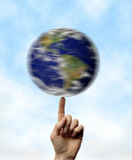 Our Planet Prints - Globe Spinning On A Finger Print by Cordelia Molloy