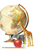 Continents Posters - Globe with toys animals on white Poster by Sandra Cunningham