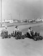 Cart Driving Posters - Go Go Cart Girls Poster by General Photographic Agency