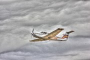 Airplane Photos Prints - Gold Plane Fighting Cloud Storms Print by Pictures HDR