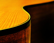 Guitar Prints - Golden Guitar Curve Print by Deborah Smith