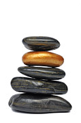 Stability Posters - Golden pebble in stack of black pebbles Poster by Sami Sarkis