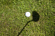 Playing Golf Prints - Golf ball and shadow Print by Mats Silvan