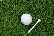 Sport Equipment Prints - Golf ball and tee on grass Print by Richard Thomas