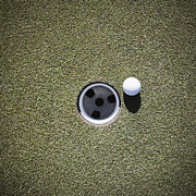 Casting A Shadow Framed Prints - Golf Ball Next to a Putting Cup Framed Print by Jetta Productions, Inc