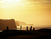 Ballycastle Photos - Golf Players Silhouetted In Front by Chris Hill