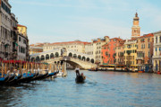 Gondolier Photo Framed Prints - Gondola at the Rialto Framed Print by Paul Cowan