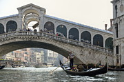 Boats In Water Prints - Gondola passing by the Rialto Bridge Print by Sami Sarkis