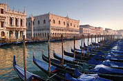 Boats In Harbor Prints - Gondolas Docked Outside Of Piazza San Print by Jim Richardson