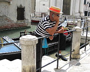 Canals Framed Prints - Gondolier On Break Framed Print by Fraida Gutovich