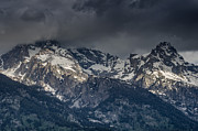 Grand Tetons Immersed In Clouds Print by Greg Nyquist