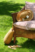 Lounging Posters - Grass lawn with a wicker chair  Poster by Sandra Cunningham