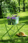 Invitation Prints - Green garden chair Print by Sandra Cunningham