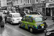 Taxi Cab Photos - Green London Taxi by Stefan Kuhn