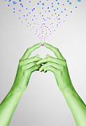 Gesturing Posters - Green Painted Hands Holding A Pink Metal Ball Poster by Paper Boat Creative
