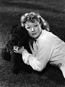 Greer Prints - Greer Garson Posing With French Poodle Print by Everett