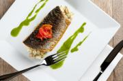 Grey Mullet Photo Posters - GREY MULLET WITH WATERCRESS SAUCE presented on a square white plate with cutlery and napkin Poster by Andy Smy