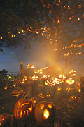 Night Scenes Photos - Grinning Lit Jack-o-lanterns by Richard Nowitz
