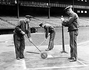 Home Plate Photo Framed Prints - Groundskeepers Preparing Home Plate Framed Print by Everett