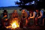 Gathering Posters - Group Of Cowboys Around A Campfire Poster by Richard Wear