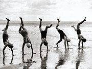 One Piece Swimsuit Prints - Group Of People Doing Handstands On Beach (b&w) Print by Hulton Archive