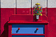 Old Fashion Framed Prints - Gum ball machine on red desk Framed Print by Garry Gay
