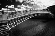 Halfpenny Prints - Halfpenny Hapenny Bridge Over The River Liffey In The Centre Of Dublin City Republic Of Ireland  Print by Joe Fox