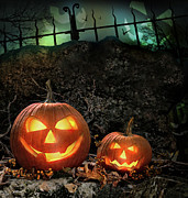 Smiling Photo Posters - Halloween pumpkins on rocks  at night Poster by Sandra Cunningham