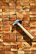 Wooden Building Prints - Hammer and stack of lumber Print by Garry Gay