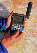 Receiver Posters - Hand-held Gps Receiver And Map Poster by David Parker