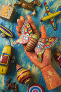 Playthings Photo Prints - Hand Holding Butterfly Toy Print by Garry Gay